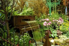 Love this!!!!! a bit out there but would be cool to bring our love for music to the backyard...for music lovers...piano of the garden