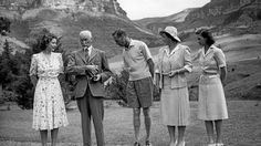 Princess Elizabeth, General Jan Smuts, King George VI, Queen Elizabeth I (Queen Mother) and Princess Margaret stand at the foot of Table Mountain - Cape Town, South Africa, 1947