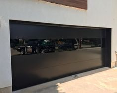 Modern Exterior Glass Garage Door Manufactured by Modern-Doors. Located at 30 Macintosh Blvd Unit 14 Concord Ontario. Clear Garage Doors, Faux Wood Garage Door, Metal Garage Doors, Modern Garage Doors, Modern Exterior Doors, Glass Garage Door, Garage Exterior, Garage Door Design, Modern Door