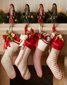 Ticking Christmas stockings @Horchow: (No longer on website...maybe next season?) I love the colors and the Ticking fabrics with the piping around the edges of the stocking. Nicely done!!!