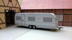 This paper model is a Puccini 685 DF Zelt Trailer, created by Volker Preikschat, and the scale is in 1:43.