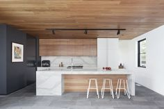 modern kitchen   west coast   wooden ceiling   modern track lighting   marble slab   white   black   timber   thick edge counter   waterfall island   stepping house   bowen architecture