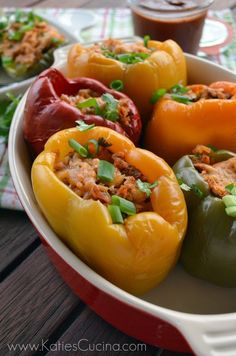 Make the perfect Father's Day meal with Slow Cooker Chicken Enchilada Stuffed Peppers. This is a mexican dish that is sure to be a hit! #FathersDay #Dad #Recipe #slowcooker