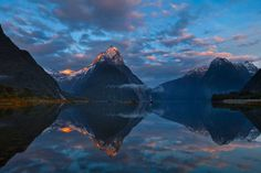 """PHOTOGRAPH AND CAPTION BY QIAN WANG Milford Sound, New Zealand """"People say 90% of the time, it is either raining or cloudy in Milford Sound, how luck I am to capture the moment whereby the thread of sunshine tipped onto the Mitre Peak for just about one minute time."""""""