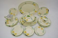 Lot 981 - An Art Deco Burleighware part dinner service painted with daffodils including a pair of tureens. Auction May estimate Sold, no price released.