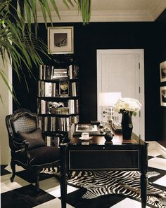 Office. Love the checkered floor with the zebra rug and the greenery in the plant. Not afraid to mix prints or to use black paint!