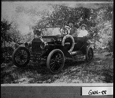 Photograph of a family riding a car on a dirt road, Gwinnett County, Georgia, ca. 1915-1920