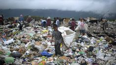 28 September 2012. A young boy collects waste at a landfill on the outskirts of Tegucigalpa, Honduras.