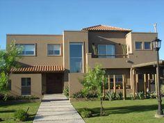 Fachada: Casas de estilo rústico por Fainzilber Arqts.