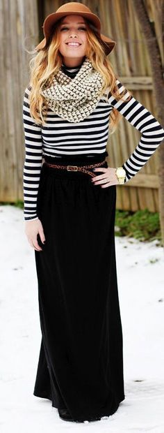 a striped shirt and a black maxi is a classic combo. add a floppy hat and a scarf as cute accessories, and put a skinny belt at your waist to look pulled together