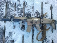 """SCAR 16S CQC       10"""" Barrel     Surefire MINI 5.56 suppressor (suppressor is 5"""" long but because of the way it attaches over the Surefire MB556k muzzle brake, only adds 2.75"""" to the length of the gun.)     Aimpoint T1 Micro in a Larue tall mount     Surefire x300 weapons light with XT07 pic rail switch     Larue FUG      Larue sling     Ergo grip"""