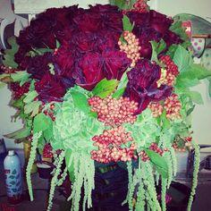 Black campanulla roses, vibirnim berries, emerald green hydrangea.