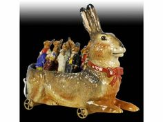 "German Paper Mache Rabbit Antique Toy Skittles Set - Nine dressed bunny skittles Metal wheels Marked on bottom ""DRGM""."
