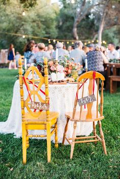 mr and mrs chairs - photo by Cara Robbins Photography http://ruffledblog.com/floral-inspired-treehouse-wedding