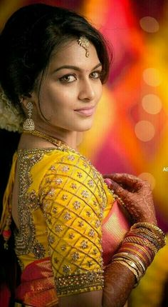 Tips from the Expert! – Make-up Artist Ibrahim On Make Up Trends in South Indian bride.Orange red silk kanchipuram sari with contrast embroidered yellow blouse.Braid with fresh jasmine flowers. Wedding Saree Blouse Designs, Silk Saree Blouse Designs, Wedding Sarees, South Indian Blouse Designs, Tamil Wedding, Blouse Patterns, Wedding Dresses, Hindu Bride, Kerala Bride