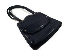 Give this a look : Vintage Lou Taylor Purse - Lou Taylor Blue Handbag https://www.etsy.com/listing/472900785/vintage-lou-taylor-purse-lou-taylor-blue?utm_campaign=crowdfire&utm_content=crowdfire&utm_medium=social&utm_source=pinterest