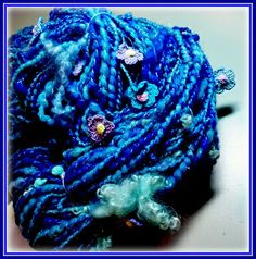 FlowerPower art yarn, spun in shades of blue.