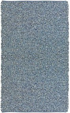 Bold, durable, and strikingly unique, the Pelle Collection of Leather Rugs is a mixture of leather and denim. This rug is hand tied and then reversed inside out and bound at the edges to create a low pile, luxuriously thick reversible leather & denim rug. This luxurious rug is made using short blue leather strips and twisted denim strips tightly double woven to a cotton foundation making it totally reversible. This weaving process creates the ultimate centerpiece of texture and dimension…