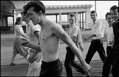 """Teens, 1959  Brooklyn teens on the beach. photo: Bruce Davidson  """" In the summer of '59 I found myself involved with a group of unpredictable youths. In time they allowed me to witness their fear, depression, and anger. I soon realized that I, too, was feeling some of their pain. In staying close to them, I uncovered my own feelings of failure, frustration, and rage."""" Bruce Davidson"""