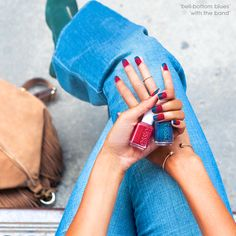 Make fashion your passion and brush on this 70's inspired essie look. Add a pop of color to your denim look with this chevron shaped nail art featuring intense midnight blue 'bell-bottom blues' and deep burgundy 'with the band' nail polish.