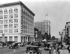 (1923)^ - View of Hollywood Blvd. at Cahuenga with traffic and pedestrians waiting to cross in 1923. The Security Trust & Savings Bank building is on the left side of the photograph.