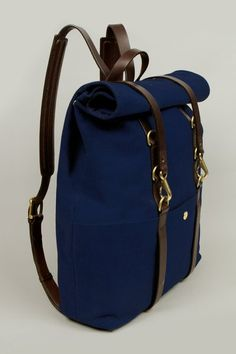 Navy blue canvas and leather backpack.