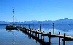 Lake Chiemsee is a freshwater lake in Bavaria, Germany, near Rosenheim. It is often called the Bavarian Sea. The rivers Tiroler Achen and Prien flow into the lake from the South; the river Alz flows out towards the north. The Alz flows into the river Inn which then merges with the Danube.