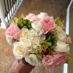 Pink garden roses are a highlight of this bouquet.  They smell wonderful!