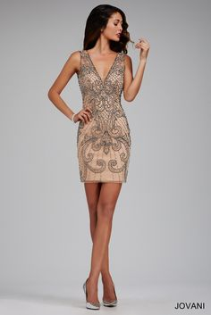 Stunning sleeveless grey cocktail dress features beaded adornments and a deep v-neckline