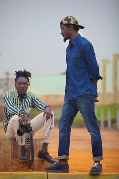 [ Travel Etiquette : Luanda, Angola Preview - Soccer field portrait of myself and Trav]  Photo by TONE