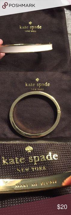 Pink kate spade bracelet Pink enamel kate spade bracelet barely worn and comes with pouch kate spade Jewelry Bracelets