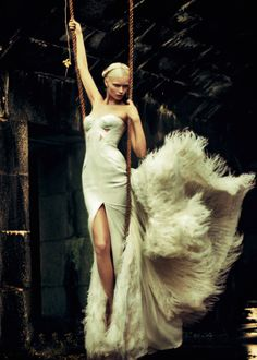 Abbey Lee Kershaw in Versace Autumn/Winter 2011-2012 ostrich feather and crepe silk gon for Charles Varenne's Madone editorial published in Numéro #126. Photo:  Sebastian Kim