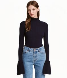 Dark blue. Rib-knit sweater in a viscose blend with ruffle-trimmed mock…