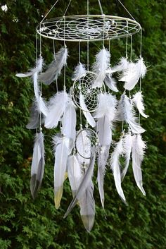 Baby Mobile, Gender Neutral Baby Dreamcatcher Mobile, Gray Silver Nursery Decor, Baby Boy Girl Nursery Mobile Catch happy dreams with this beautiful dream catcher mobile. Light and airy, a gentle breeze makes the feathers flutter and dance. This beautiful baby mobile made on sturdy metal hoops wrapped in silver satin ribbon. Webbed with white cotton thread and a few silver/clear crystal beads. Feather colors are snow white and light gray with silver beads detailing. Some of the feathers ...