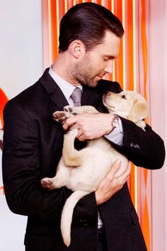 Hot guys holding puppies is the single greatest phrase in the history of human kind #fact