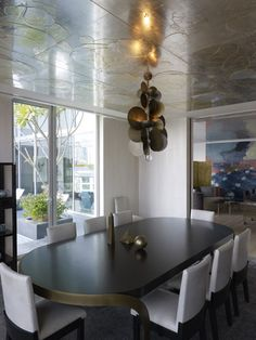 Dining room: wallpaper on ceiling, lovely brass fixture = Singapore Penthouse | design by Sara Story Design