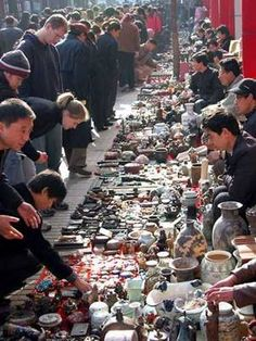 Beijing Panjiayuan Antique Market. Oh what I'd dig up there. I could hunt for days there!!!!