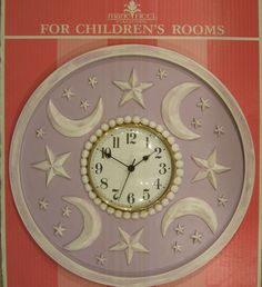 "Moon and Stars kids clock by Marie Ricci. Shown in distressed lilac. 18"" clock with 6"" face. www.mariericci.com $200"