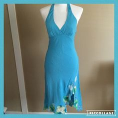 BCBG Max Azria Turquoise Silk Halter Dress Size 6 You will turn heads in this gorgeous size 6 turquoise BCBG Max Azria halter dress with flowers on bottom. I love the flowy chiffon material on the one. 100% silk. Note there is a small circular discoloration on the bottom of the dress. It's very difficult to notice (see last photo) able but I like to point out everything. This is a gorgeous dress! BCBGMaxAzria Dresses Backless