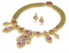 A gold cannetille, pink topaz and diamond demi-parure, circa 1820  The necklace designed as an articulated fringe of oval, pear and cushion-shaped pink topaz, within borders of beaded gold wire highlighted by cushion and pear-shaped diamonds, on a triple gold chain of interlaced circular links, accompanied by a brooch and a pair of earrings (later converted), diamonds approximately 9.60 carats total, necklace length 42.2cm, earring length 1.8cm, brooch length 4.4cm