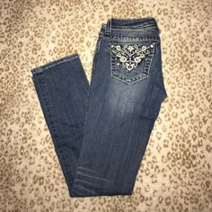 Miss Me jeans So cute!! Miss me's size 26, I've probably only worn them twice. I started weightlifting and I just can't fit into them anymore.. so sad because I LOVE this style. they're in great shape! Miss Me Jeans Straight Leg