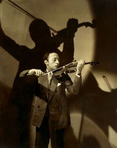 """Jascha Heifetz Playing Violin"" by Edward Stieglitz, 1928 - I love the use of shadow in this portrait.  It creates a visual sense of musical energy filling the space."