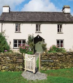 Nestled in a small hamlet alongside a babbling brook, Yew Tree Farm is one of the many properties once owned by Beatrix Potter.