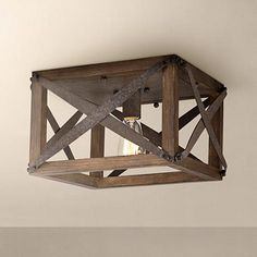 This handsome flushmount ceilinglight features a rustic-industrial look a wood frame surrounding an Edison-style light bulb. wide x 8 high. Includes one medium base 60 watt decorative Edison bulb. Style # at Lamps Plus. Rustic Lighting, Industrial Lighting, Rustic Industrial, Hallway Lighting, Farmhouse Lighting, Bedroom Lighting, Rustic Modern, Kitchen Lighting, Rustic Style
