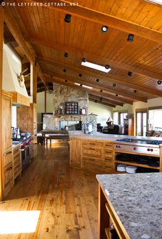 in my dreams, i live in the pioneer woman's (ree drummond's) house and cook with her in this kitchen. gorgeous wood everywhere.