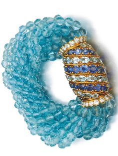 Carier circa Of torsade design, the barrel clasp set with oval sapphires and aquamarines and accented with brilliant-cut diamonds, suspending ten lines of faceted aquamarine beads Cartier Diamond Bracelet, Cartier Jewelry, Antique Jewelry, Vintage Jewelry, Diamond Necklaces, Diamond Bangle, Jewellery, Sapphire Diamond, High Jewelry
