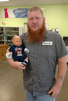 Keenan Watkins of North Vernon, Indiana put his pride on the line when he walked into a Goodwill store with a baby doll strapped to his cart, but the story behind the odd scenario is deeply touching - and it's going viral for all the right reasons.