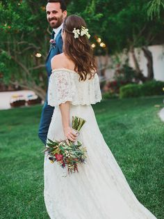 The off-the-shoulder look isn't just for crop tops. This flirty sleeve detail is the hottest trend for a boho wedding dress that is light and free flowing.