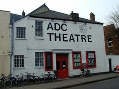 ADC Theatre, Park Street, Cambridge.    The Amateur Dramatic Club, the country's oldest university playhouse, was founded in 1854, moving to the present location in 1860. The theatre building itself, located behind, was destroyed in a fire in 1933 and the current theatre, designed by Harold Tomlinson and W.P. Dyson, opened in 1935.