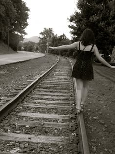 Amber on the Tracks fine art photograph by Ellie O'Connor 2012. My beautiful best friend on the train tracks in our home town.